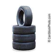 The stack of four winter new tires over white