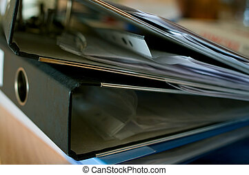 stack of full ring binder files - The stack of full ring...