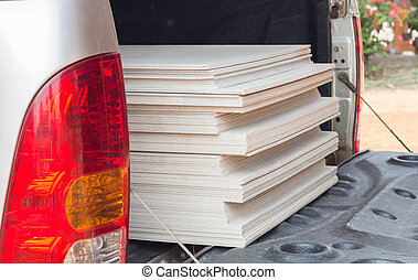 The stack of gypsum board for construction on the truck.