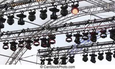 The stage lamps on open air in the city in cloudy day, close...