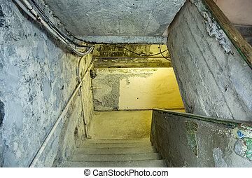 The staircase in the ruined house