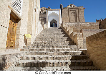 The stairway to the entrance at the Shah-i-Zinda, Samarkand, Uzbekistan. Shah-i-Zinda is a necropolis in the north-eastern part of Samarkand. It includes mausoleums and other ritual buildings of 9-14th and 19th centuries. Shah-i-Zinda, meaning The living King, is connected with the legend that Kusam...