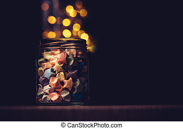 the Star origami in glass jar with festival light , symbol for gift celebration in happy time