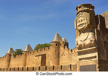 The statue of Dame Carcas outside Carcassonne, France - The...