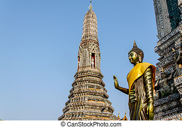 The statue of Golden Buddha in Wat Arun. Thai traditional Buddh