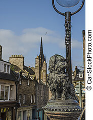 The statue of Greyfriars Bobby, a famous Terrier, in front of the Greyfriars cemetery in Edinburgh, Scotland, UK