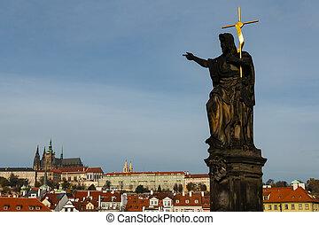 The statue of John the Baptist on Charles bridge in Prague