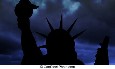 The Statue Of Liberty Of New York City Against Time Lapse Clouds.