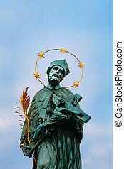 The statue of St. John of Nepomuk on Charles bridge in Prague