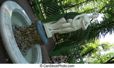 The statue of the girl. Fountain. Girl. Summer garden. Saint-Petersburg. 4K.