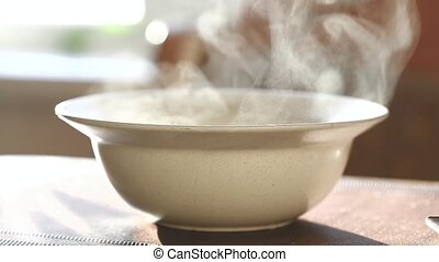 the steam rises above the plate