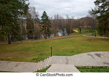 The steps on the lawn go down to the river