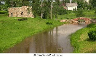The stone bridge over the river. The estate Marino. 4K.