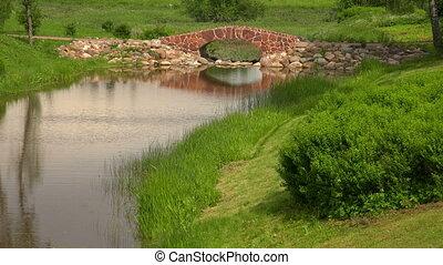 The stone bridge over the river. The estate Marino.