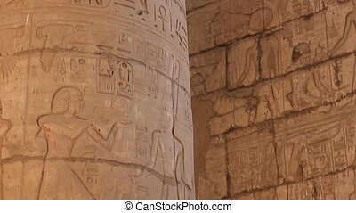 The detail stone columns with relief carving in Ancient Egyptian temple complex located on the east bank of the Nile River.