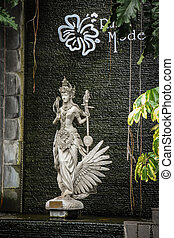 The stone statue in front of Rumah Mode, Bandung, a famous factory outlet store in Bandung