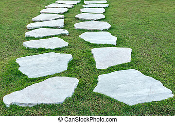 the stone walk path with green gras