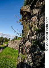 The stone wall of the fortress