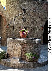The stony well in Asciano, Tuscany