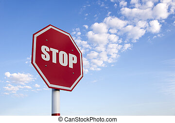 The stop traffic sign with the sky and cloud