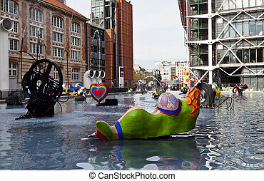 The Stravinsky Fountain is a shallow basin of 580 square meters located in Place Stravinsky, between the Centre Pompidou and the Church of Saint-Merri in Paris, France