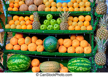 The street counter is a display case with beautifully neatly arranged fruits. Turkish style fruit layout