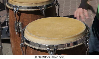The street drummer plays drums - The street drummer plays...
