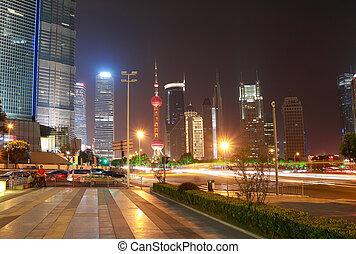 The street scene of the century avenue in shanghai,China. -...
