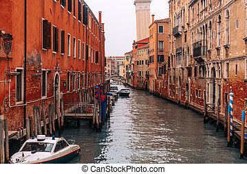 The street with a boat in Venice, Italy.