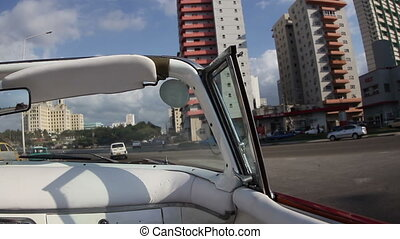 the streets of havana, cuba, filmed from a convertible classic car