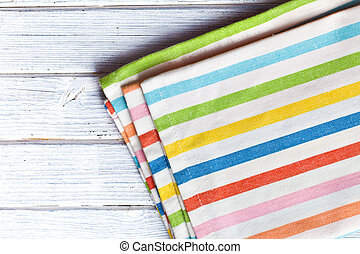 the striped kitchen napkin on wooden table