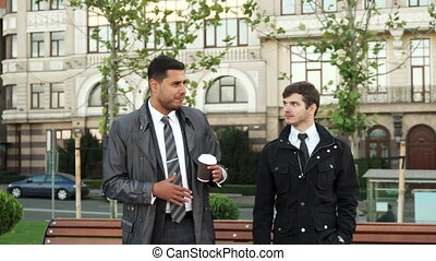 The strolling men discuss something serious - Two men slowly...