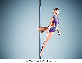 The strong and graceful young girl performing acrobatic...