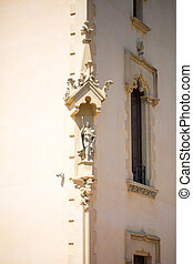 The stucco on corner of the house