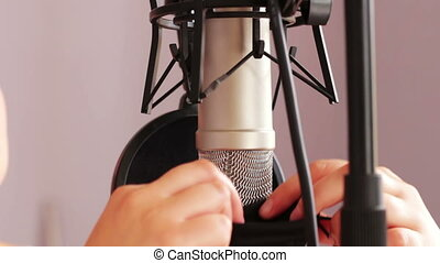 The studio microphone is covered with cover after use - The...