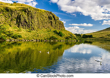 The summer view of the mountains reflected in a lake