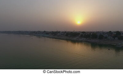 The sun and the canal - A dolly, aerial view of the hot sun...