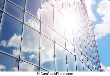the sun and the sky in a glass building