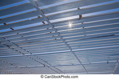 the sun breaks through the roof