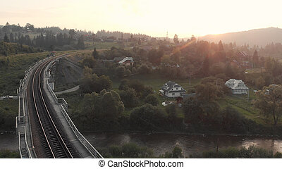The sun goes down over the railroad.