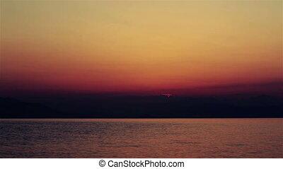 The sun in heart shape rising
