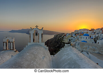 The sun is setting in Oia