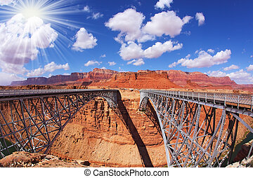 The sun is shining over Navajo Bridge