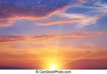 the sun rays illuminate the sky above the horizon