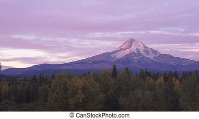 The Sun Rises on Mount Hood Clouds Pass Overhead