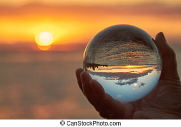 crystal ball - The sun sets over Lake Constance in Germany ...