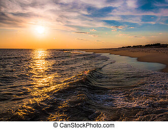 The sun setting over the Atlantic Ocean, Cape May, New...