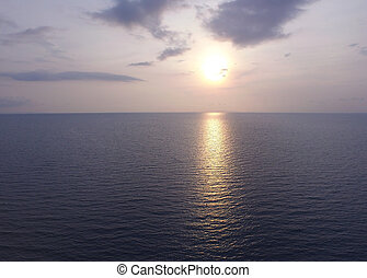 The sun setting over the calm sea in Thailand, photo by drone