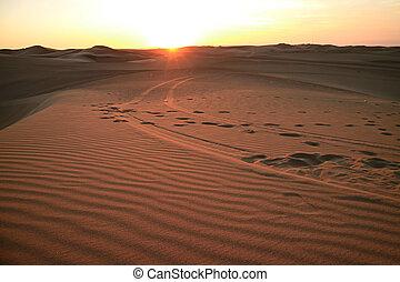 The sun setting over the sand dune of Huacachina desert, Ica region, Peru, South America