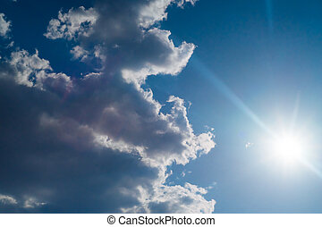 The sun shines bright in summer. Blue sky and clouds.